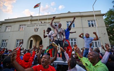 Zimbabweans Celebrate in the Streets After Resignation of President